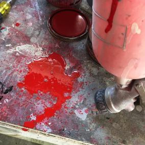 Spilled Red Paint Ford Unibody