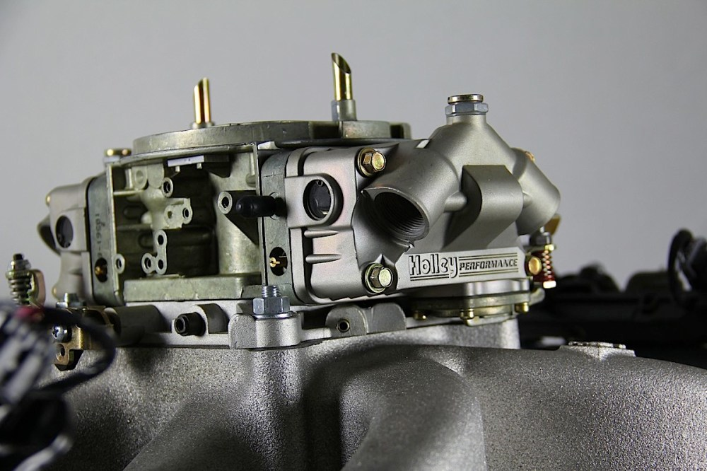 medium resolution of a carburetor is a device that sits on top of an intake manifold and has one basic job to properly mix air and fuel for delivery into an engine