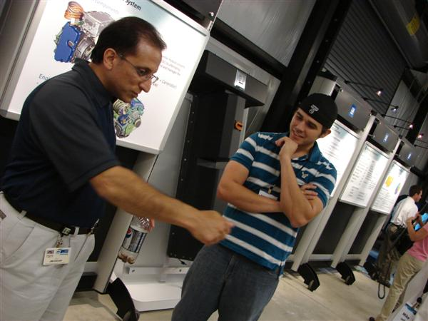 Raymond discusses adapter theory with plug-in connector lead Jim Khoury.