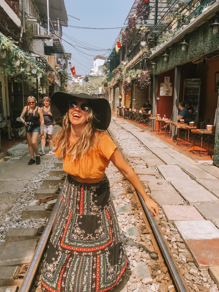 spellbound travels girl on train street hanoi vietnam