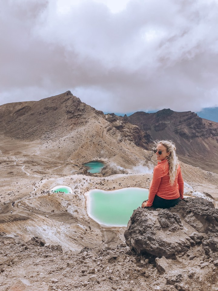 spellbound travels girl at top of tongariro crossing new zealand hike
