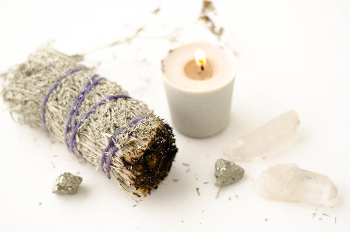 Sage smudge and white candle spell