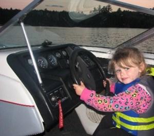 kid-driving-boat