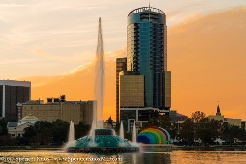 One of my personal favorite photos, looking West at the Lake Eola fountain and a downtown high rise at sunset.