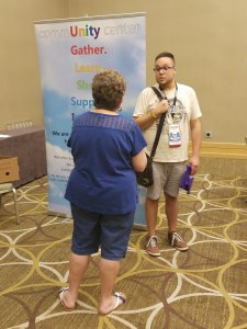 A workshop participant stays after the session to ask a question from Judi Epp, Spencer Pride's treasurer & volunteer coordinator.