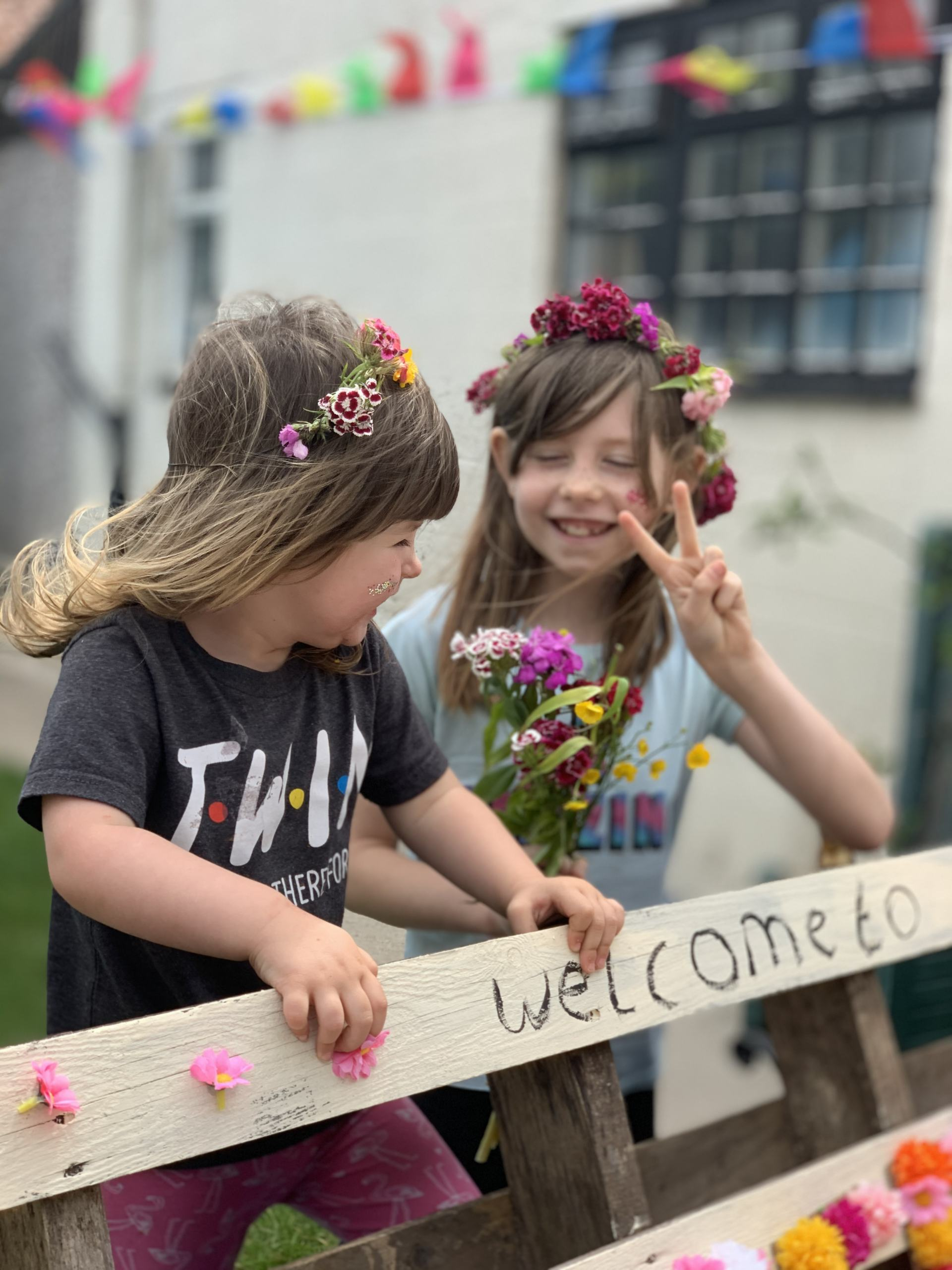 two girls with flower crowns on