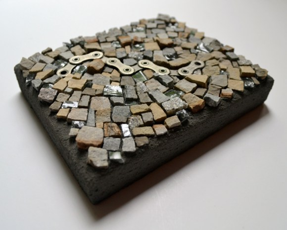 """""""The Missing Link"""" by Julie Sperling (2014) - stone from the Ottawa area, glass (from a broken table), and bike chain"""