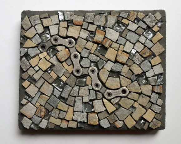 """The Missing Link"" mosaic by Julie Sperling (2014) - stone from the Ottawa area, glass (from a broken table), and bike chain"