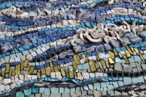 Wind power and solar power detail of mosaic about renewable energy by Julie Sperling