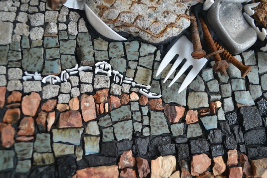 mosaic detail of anthropocene using red dog, coal, ceramic, and plastic