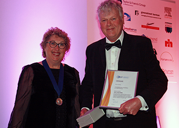 Roger Haslam PhD, editor-in-chief of Ergonomics, accepts the 2017 Liberty Mutual Award on behalf of the study authors. Dr. Claire Dickinson, president of CIEHF, presented the award at the annual Ergonomics & Human Factors conference, held April 25-27 in Daventry, Northamptonshire, UK.