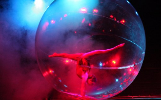 Sensia, hula-hoop and acrobatic in transparent sphere