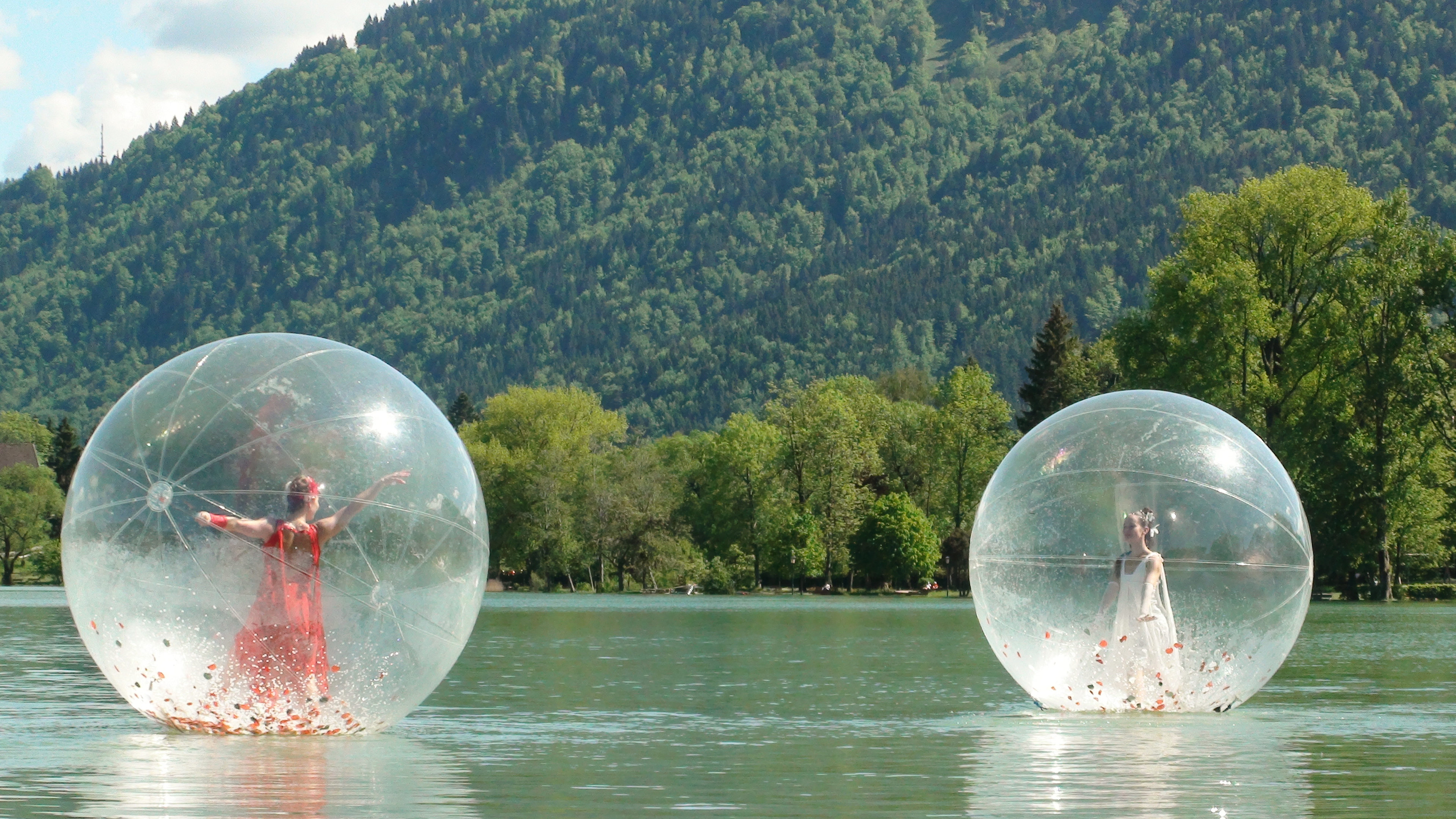 dance and acrobatic performances in the stunning plastic spheres.