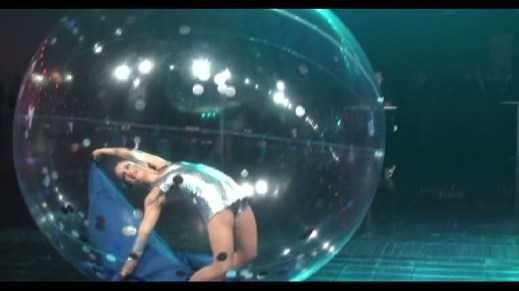 dynamic dance show in transparent spheres