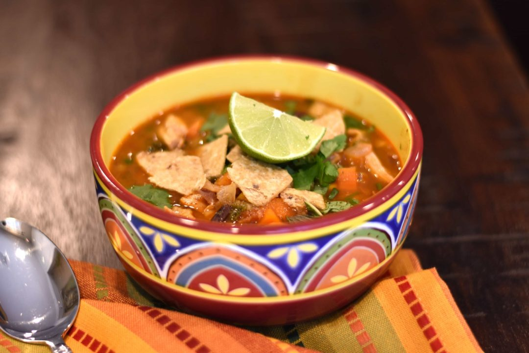 Chicken Tortilla Soup, Chicken Taco soup in instant pot by Spice Cravings. This20-minute Chicken Tortilla Soup instant pot recipe combines the flavors of chili powder, cumin, lime juice, & paprika, with tender chicken, beans, & sweet corn. #food #foodie #foodblogger #delicious #recipe #instantpot #recipes #easyrecipe #cuisine #30minutemeal #instagood #foodphotography #tasty