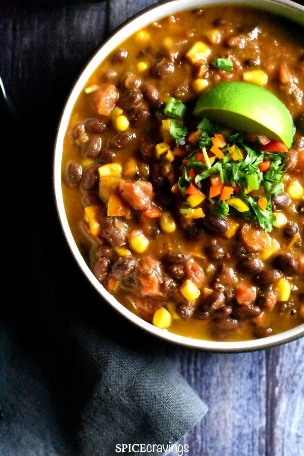 Top partial view of a bowl with vegetarian and vegan black bean chili