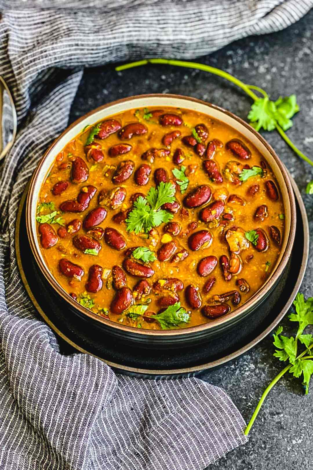Rajma masala garnished with green chillies and cilantro