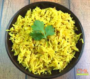 Instant pot Lemon Rice by Spice Cravings. Lemon Rice, fluffy grains of aromatic Basmati rice, flavored with mustard seeds and fresh lemon juice. This satisfying side pairs well with Indian, middle-eastern or Greek entrees. I like to serve it with grilled chicken and vegetables, or with Lamb Chops or kebabs. #food #foodie #foodblogger #delicious #recipe #instantpot #recipes #easyrecipe #cuisine #30minutemeal #instagood #foodphotography #tasty