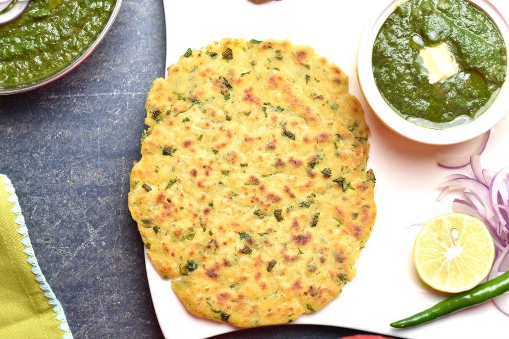 Instant Pot Saag served with Makki ki Roti and onions on the side