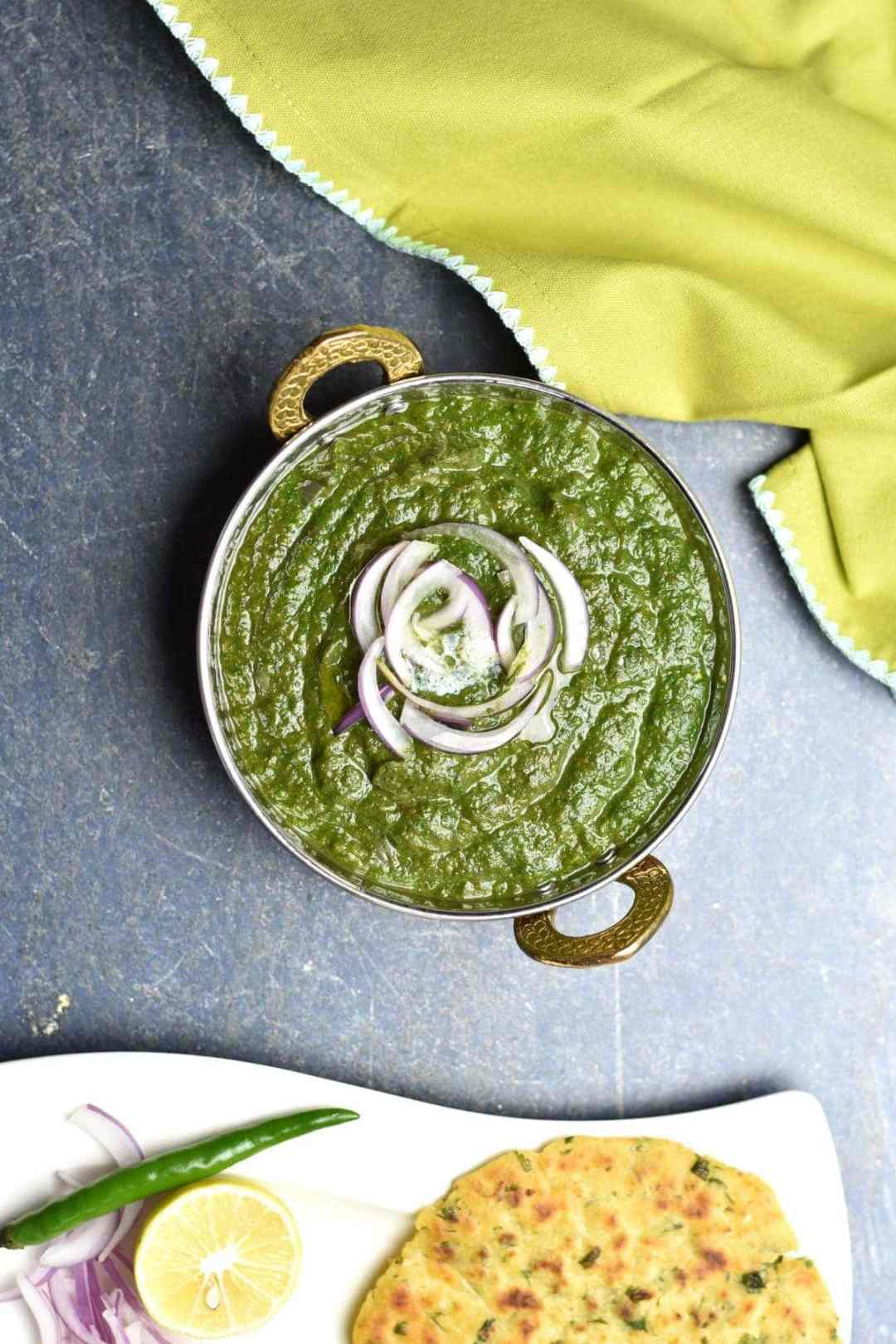 Sarson ka Saag, Indian spiced Mustard Greens by Spice Cravings. Sarson ka Saag is a leafy-vegetable preparation from Punjab, in the north of India. Traditionally a winter-time speciality, it is prepared with mustard greens & spinach, seasoned with onions, ginger, garlic, & warm Indian spices. It is usually served with makki ki roti, which is a cornmeal flatbread. #cooking #food #recipe #recipes #foodphotography #foodblogger #yummy #delicious #foodie