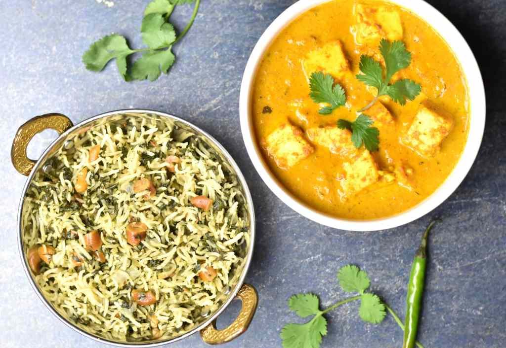 Butter Paneer with this flavorful and hearty spinach rice, palak pulao or pilaf is made by cooking aromatic basmati rice with buttery soft spinach in ghee in an Instant Pot. by Spice Cravings. #cooking #food #recipe #recipes #foodphotography #foodblogger #yummy #delicious #foodie