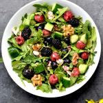This fresh and flavorful Berry Arugula Salad with Strawberry Vinaigrette is a must-have this summer. Sweet berries tossed with crisp cucumber, crunchy walnuts and salty feta cheese, and dressed with the best vinaigrette you'll ever make-- Fresh Strawberry Vinaigrette! #food #foodie #foodblogger #delicious #recipe #instantpot #recipes #easyrecipe #cuisine #30minutemeal #instagood #foodphotography #tasty #wprecipemaker #salad #lowcarb #glutenfree #vegetarian #raspberries #blueberries #blackberries #strawberries #vinaigrette #15minutemeals #summerrecipes #spicecravings