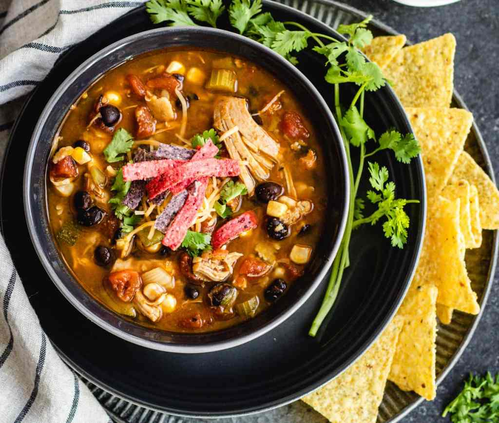 Instant pot chicken tortilla soup topped with shredded cheese