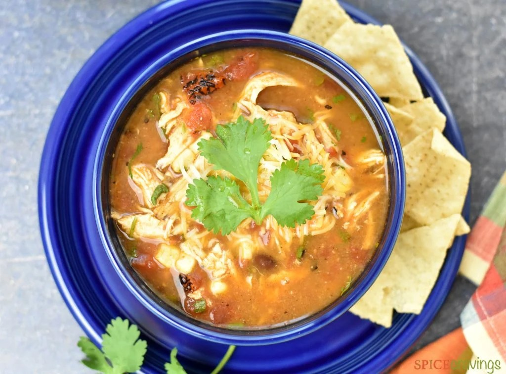 Top view of bowl of Instant pot chicken tortilla soup with tortilla chips on the side