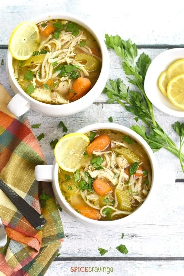 Two bowls of gluten free chicken noodle soup made in instant pot
