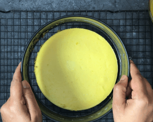 Removing the springform pan ring from Mango cheesecake