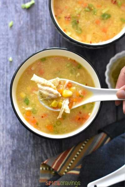 A spoon full of Instant Pot chicken sweet corn soup