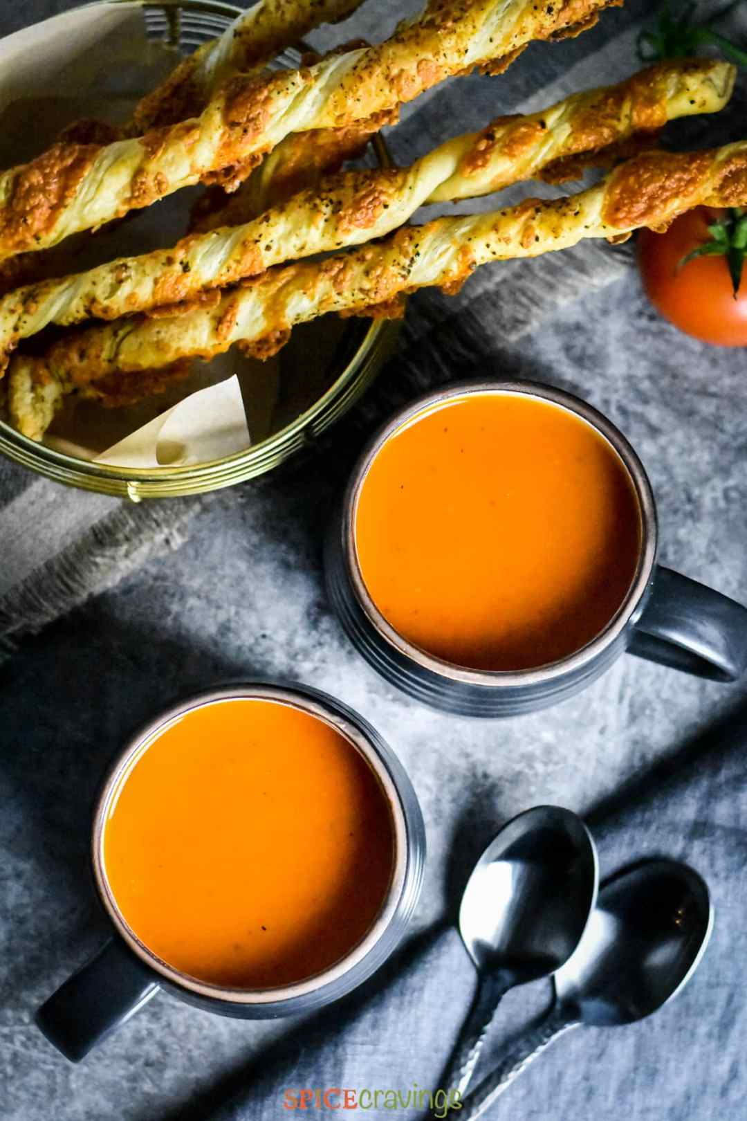 2 black cups of Roasted Red Pepper Tomato Soup made in Instant Pot
