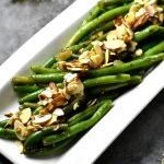 Instant Pot green beans almondine served on a white tray