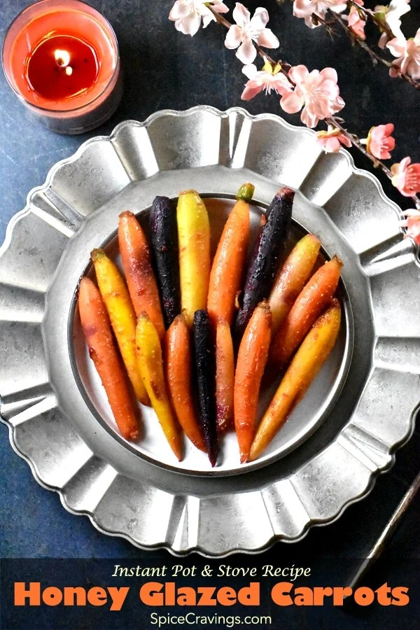 These crisp, tender and citrusy sweet Honey Glazed Carrots are a delicious and colorful side, fit for any occasion. This recipe is quick and easy to elevate weeknight dinners, and elegant enough to compliment any holiday spread. #spicecravings #carrots #sides #thanksgiving #christmas #holiday #instantpot #vegetables #glutenfree
