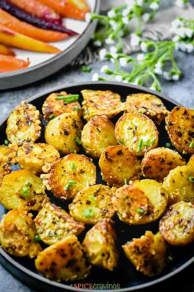 Crispy Parmesan roasted potatoes cooked in instant pot, then roasted in the oven, garnished with chopped chives