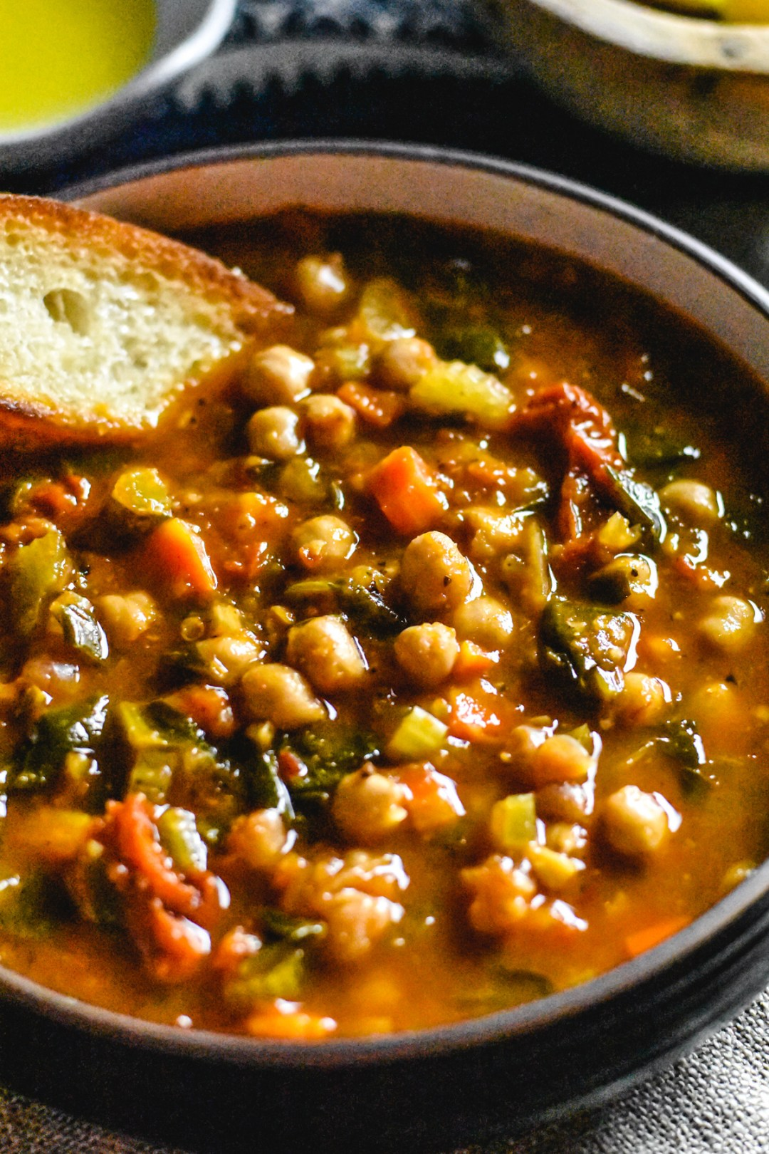 A bowl of moroccan chickpea soup served with olive oil