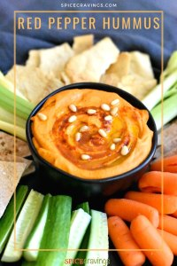 Roasted red pepper hummus garnished with pine nuts and paprika