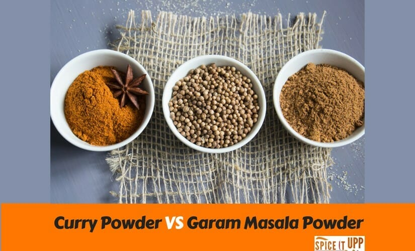A bowl of curry powder and garam masala powder on a mat to explain the difference between the two