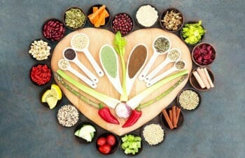 Assorted spices kept in a heart shape for spice list and their benefits