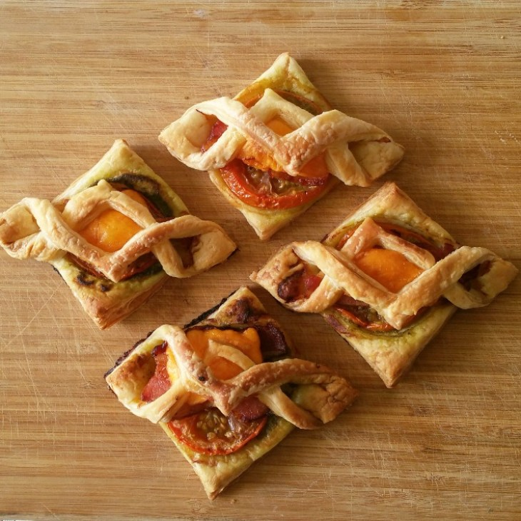 Flakey tarts on a wooden cutting board