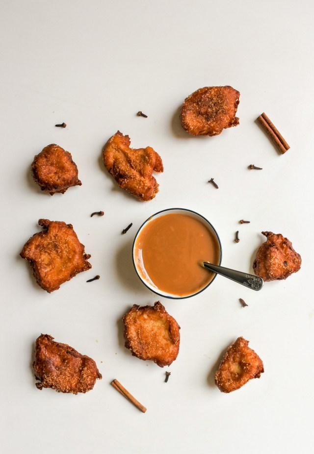 apple churro fritters with scattered spices and dulce de leche dipping sauce