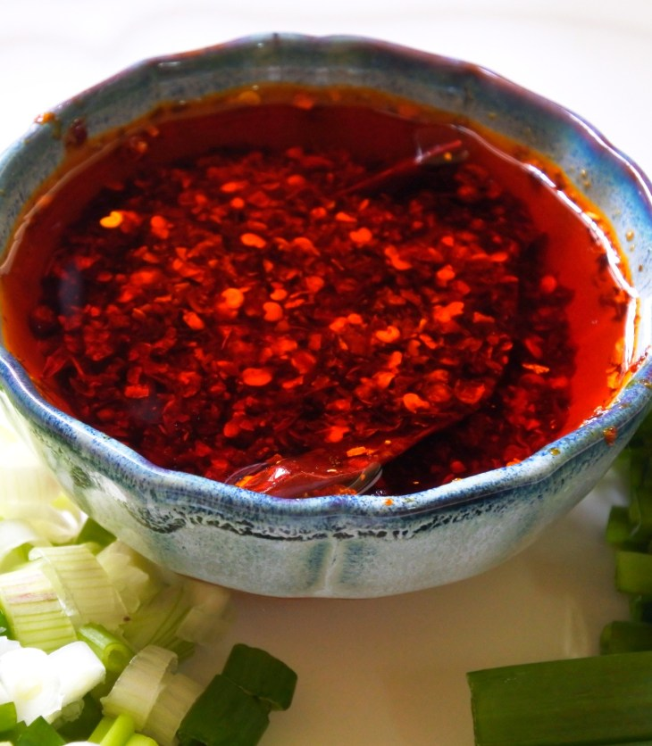a bowl of Chinese chile oil (la jiao) with scallions