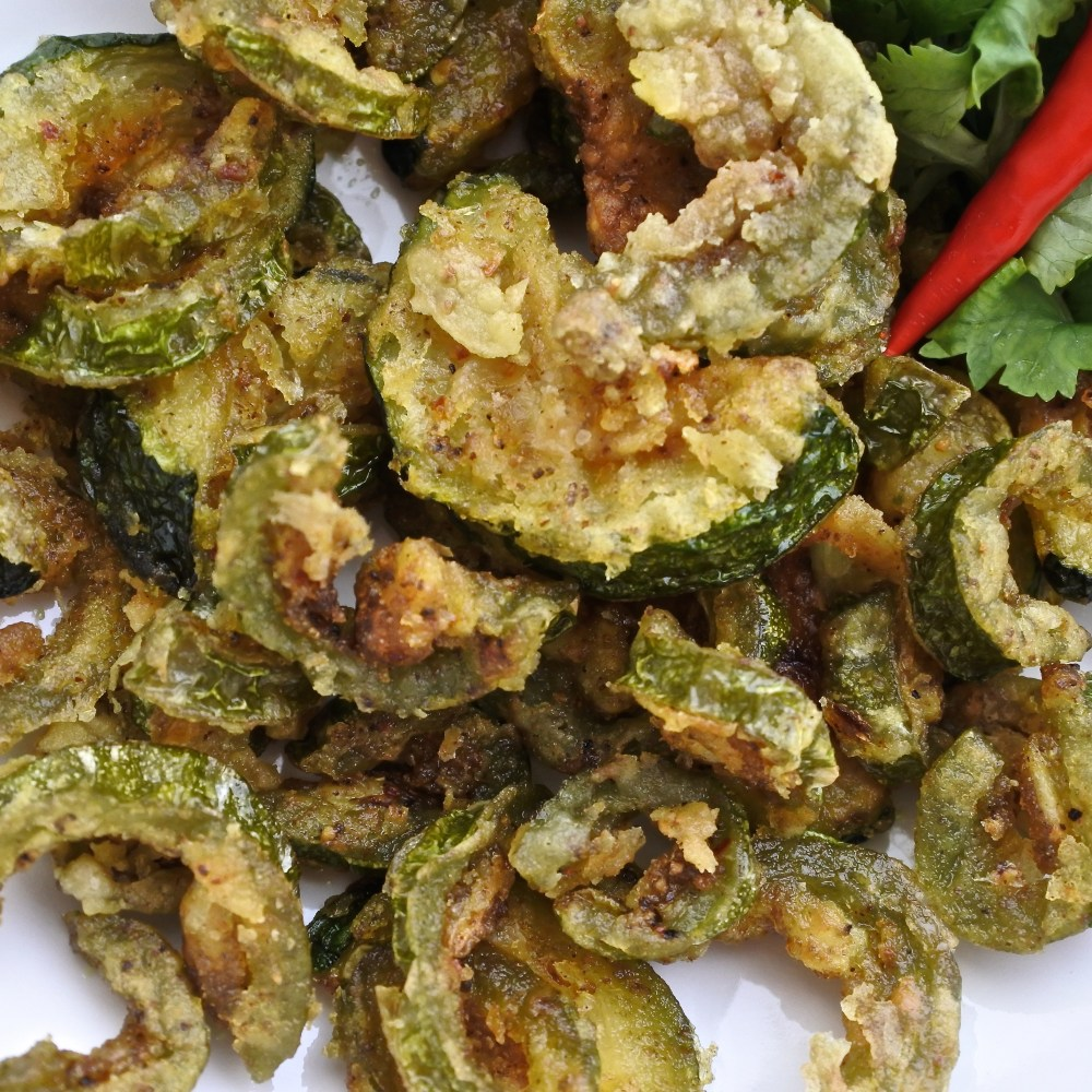 Karela chips with fresh cilantro and red chiles