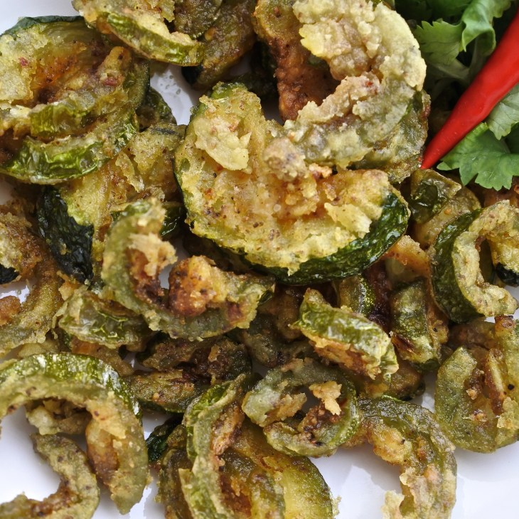 Fried bitter gourd with fresh cilantro and red chilis