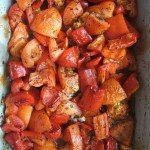 cooked chopped tomatoes, bell peppers and garlic in casserole dish