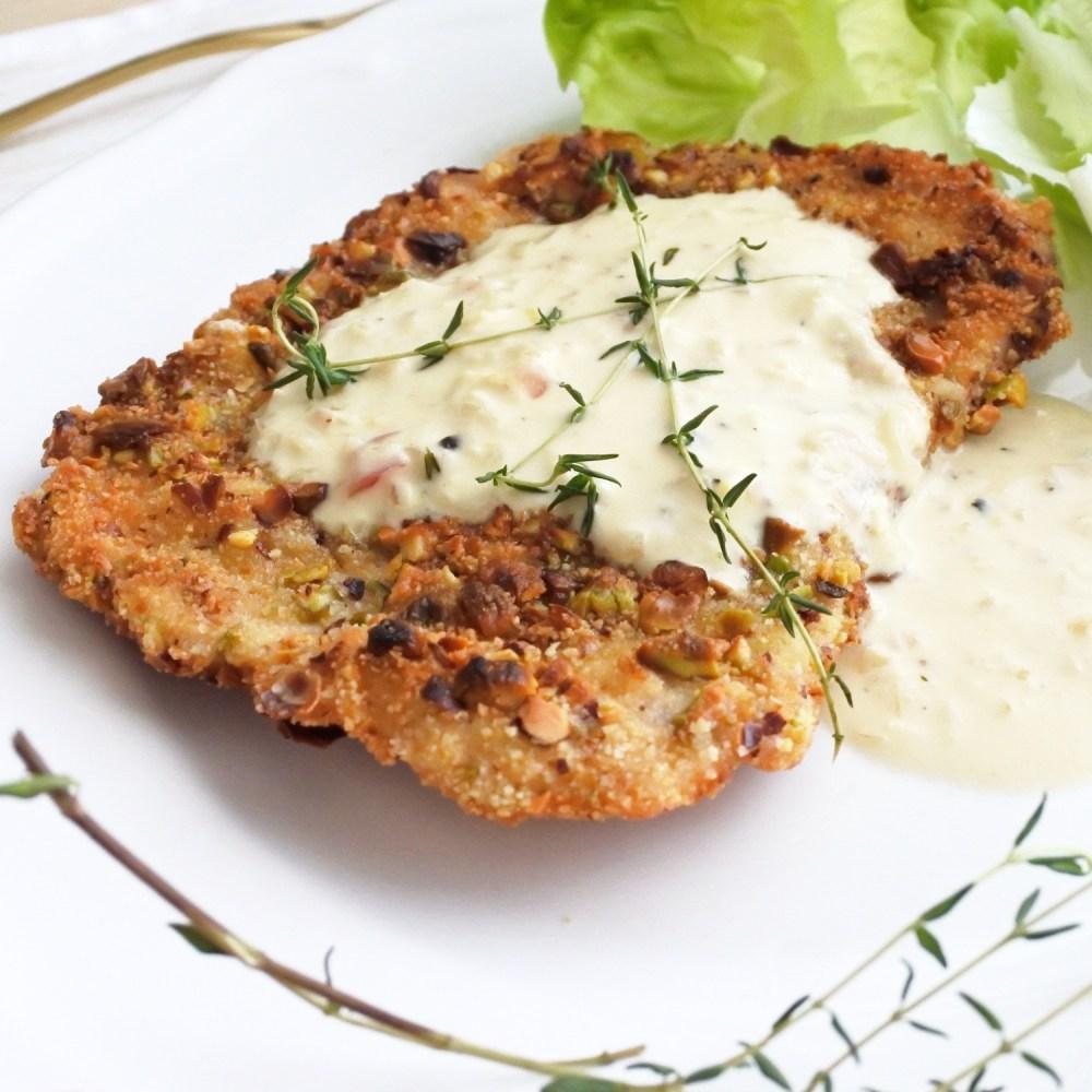Pistachio encrusted pork loin cutlet with cream sauce