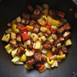 tofu and vegetables frying in wok
