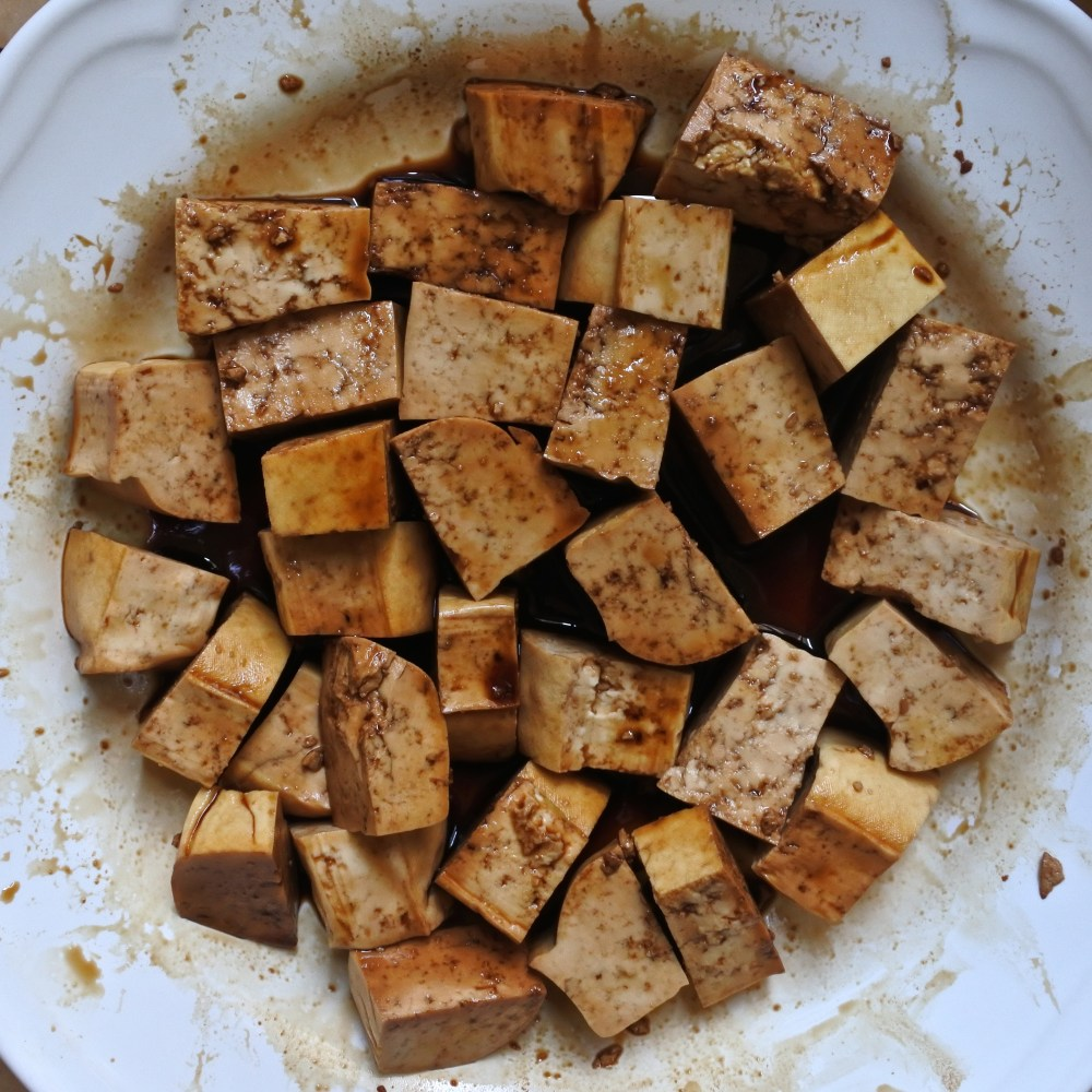 diced tofu marinating in soy sauce