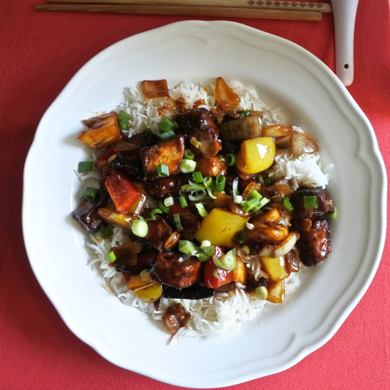 Sweet and Sour Tofu over a plate of steamed rice