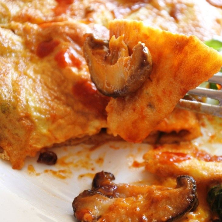 a piece of omelette with Thai chile mushrooms inside